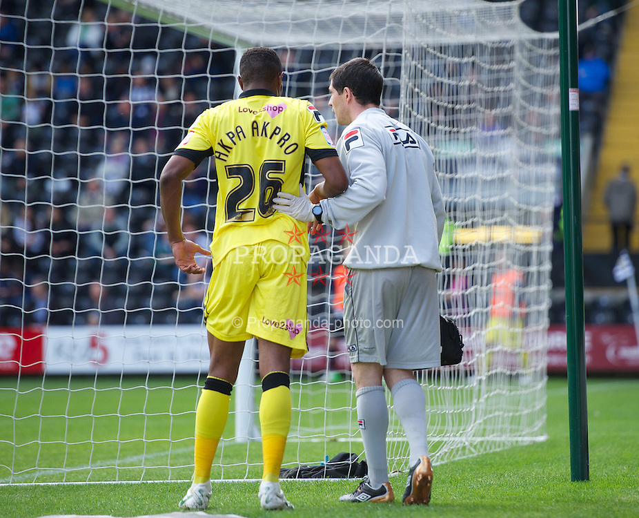 NOTTINGHAM, ENGLAND - Saturday, October 6, 2012: Tranmere Rovers' Jean-Louis Akpa Akpro limps off injured against Notts County during the Football League One match at Meadow Lane. (Pic by David Rawcliffe/Propaganda)