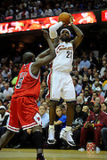 Apr 27, 2010; Cleveland, OH, USA; Cleveland Cavaliers forward LeBron James (23) shoots over Chicago Bulls forward Luol Deng (9) during the first period in game five in the first round of the 2010 NBA playoffs at Quicken Loans Arena.  Mandatory Credit: Jason Miller-US PRESSWIRE
