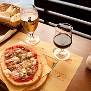 At the restaurant Casa Verdi Italian pizza served with beer or red wine is a favorite dish in Italy.