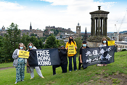 Edinburgh, Scotland, UK. 7 August, 2020. Hong Kong pro-democracy protesters on Calton Hill in Edinburgh as part of the regular Fridays for Freedom protests held in cities across the world in support of the pro-democracy movement in Hong Kong. Iain Masterton/Alamy Live News