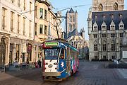 De Lijn tram travels along route 4 to Zwinjaardebrug in central Ghent, Belgium.