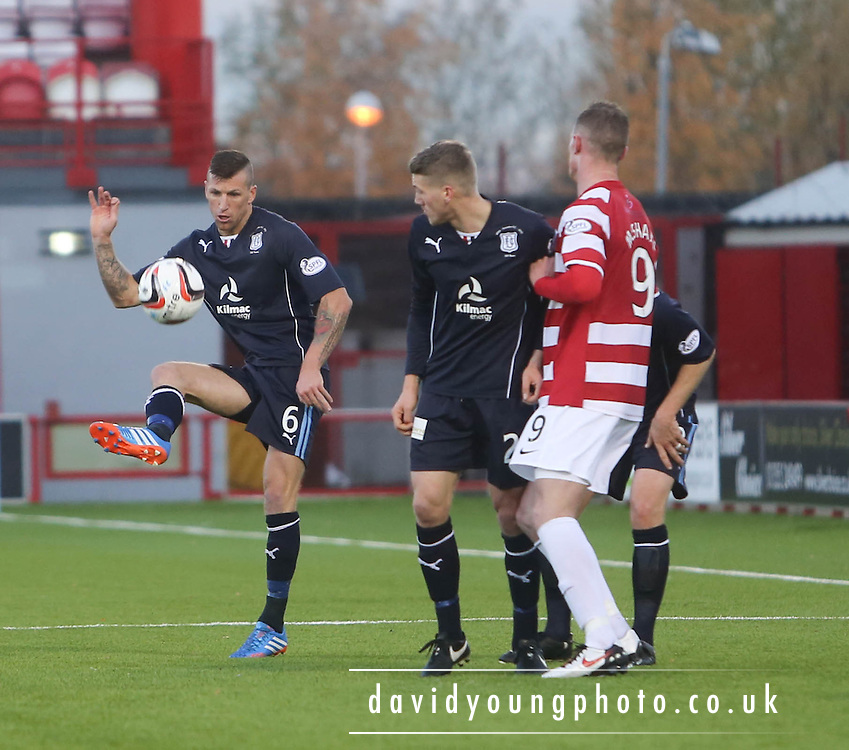 Iain Davidson clears while Jim McAlister and Jon McShane watch - Hamilton Academical v Dundee, SPFL Championship at New Douglas Park<br /> <br />  - &copy; David Young - www.davidyoungphoto.co.uk - email: davidyoungphoto@gmail.com