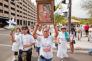 22 JULY 2010 -- PHOENIX, AZ: Georgina Sanchez (CQ) carried a painting of the Virgin of Guadalupe and Pope John Paul II while she led a procession through downtown. Thousands of people came to the Sandra Day O'Connor United States Courthouse (CQ) in downtown Phoenix Thursday. PHOTO BY JACK KURTZ