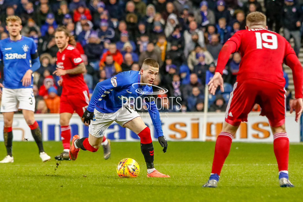 Ryan Kent takes on Lewis Ferguson of Aberdeen FC during the William Hill Scottish Cup quarter final replay match between Rangers and Aberdeen at Ibrox, Glasgow, Scotland on 12 March 2019.