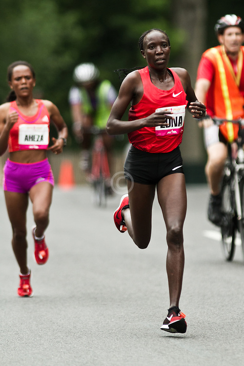 NYRR Mini 10K road race (40th year); Edna Kiplagat, Kenya, breaks away from lead pack