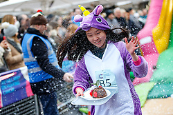 © Licensed to London News Pictures. 03/12/2016. London, UK. Participants compete in The Great Christmas Pudding Race in Covent Garden, London to support Cancer Research UK on Saturday, 3 December 2016. Photo credit: Tolga Akmen/LNP