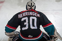 KELOWNA, CANADA - NOVEMBER 22: Michael Herringer #30 of Kelowna Rockets stretches during warm up against the Portland Winterhawks on November 22, 2014 at Prospera Place in Kelowna, British Columbia, Canada.  (Photo by Marissa Baecker/Shoot the Breeze)  *** Local Caption *** Michael Herringer;