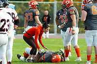 KELOWNA, BC - OCTOBER 6: Athletic therapist Sammy Levin tends to Karn Sidhu #95 of Okanagan Sun on the field against the VI Raiders at the Apple Bowl on October 6, 2019 in Kelowna, Canada. (Photo by Marissa Baecker/Shoot the Breeze)
