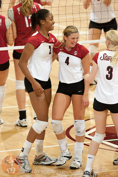 November 25, 2006; Stanford, CA, USA; Stanford Cardinal middle blocker Janet Okogbaa (2) and setter Bryn Kehoe (4) celebrate during the game against the Washington State Cougars at Maples Pavilion. The Cardinal defeated the Cougars 30-27, 30-23, 30-18.