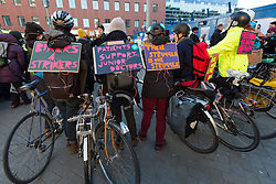 © Licensed to London News Pictures. 12/01/2016. London, UK. Cyclists with banners, Junior doctors and supporters picket outside the Royal London Hospital in Whitechapel, east London. Junior doctors across England are taking strike action today after talks failed between the British Medical Association (BMA), NHS bosses and Health secretary, Jeremy Hunt regarding a new contract, weekend pay and working hours. Photo credit : Vickie Flores/LNP