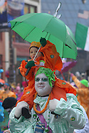 PHILADELPHIA - JANUARY 1:  Bill Hershman carries Billy Hershman on his shoulders with the Froggy Carr Comics Brigade as  they strut along the parade route during the 107th Annual New Year's Day Mummer's Parade January 1, 2008 in Philadelphia, Pennsylvania. Thousands came out to watch the annual event as it paraded up Broad Street after a three hour rain delay..(Photo by William Thomas Cain/Getty Images)