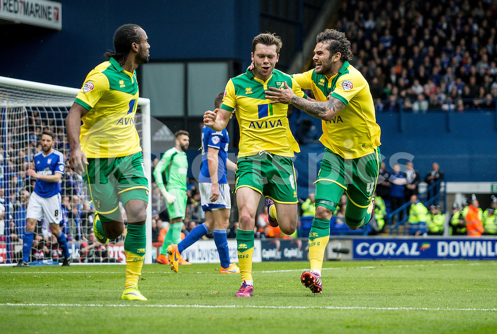 Jonathan Howson of Norwich City celebrates scoring with Cameron Jerome of Norwich City and Bradley Johnson of Norwich City during the Sky Bet Championship Play Off 1st Leg match between Ipswich Town and Norwich City at Portman Road, Ipswich, England on 9 May 2015. Photo by Liam McAvoy.