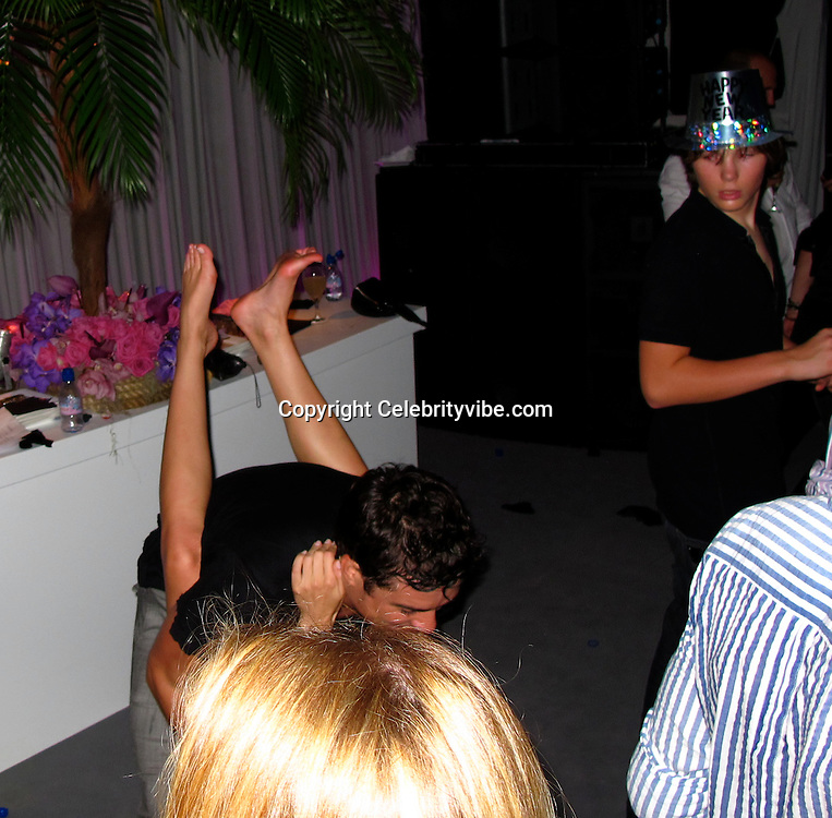 **EXCLUSIVE**.Orlando Bloom and Miranda Kerr..Roman Abramovich New Year's Eve Party with Special Performance by Gwen Stefanie. .Private Resident of Russian Billionaire Roman Abramovich..St Barth, Caribbean..Thursday, December 31, 2009..Photo By Celebrityvibe.com.To license this image please call (212) 410 5354; or Email: celebrityvibe@gmail.com ; .website: www.celebrityvibe.com.