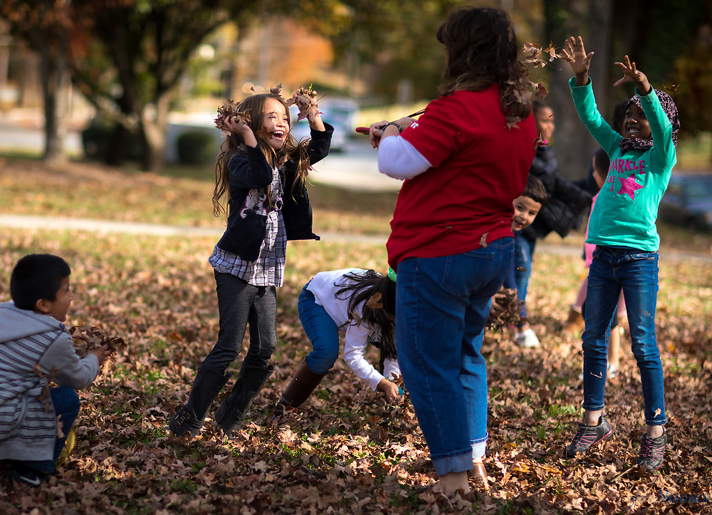 1st grade teacher, Debbie Lake, has a brief leaf fight with her students on the lawn of Irving Park Elementary.<br /> <br /> Photographed, Friday, November 17, 2017, in Greensboro, N.C. JERRY WOLFORD and SCOTT MUTHERSBAUGH / Perfecta Visuals