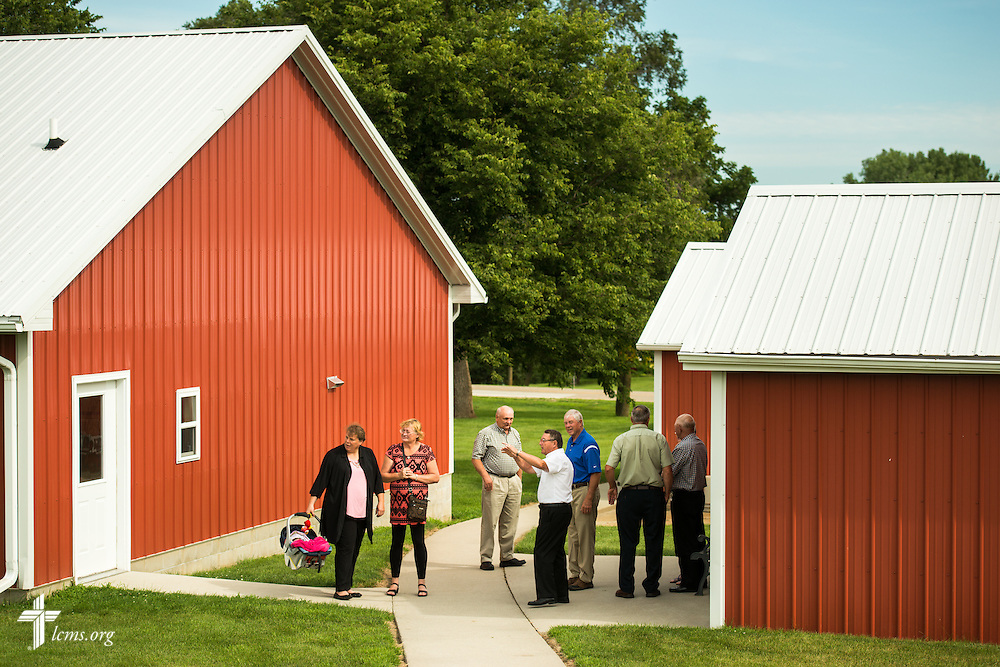 Gary Thies (center, with arm up) directs visitors to the sanctuary and mission museum at Mission Central on Sunday, July 19, 2015, in Mapleton, Iowa. LCMS Communications/Erik M. Lunsford