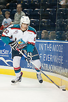 KELOWNA, CANADA - SEPTEMBER 5: Alexander Uryga #12 of Kelowna Rockets skates with the puck against the Prince George Cougars on September 5, 2015 during the first pre-season game at Prospera Place in Kelowna, British Columbia, Canada.  (Photo by Marissa Baecker/Shoot the Breeze)  *** Local Caption *** Alexander Uryga;