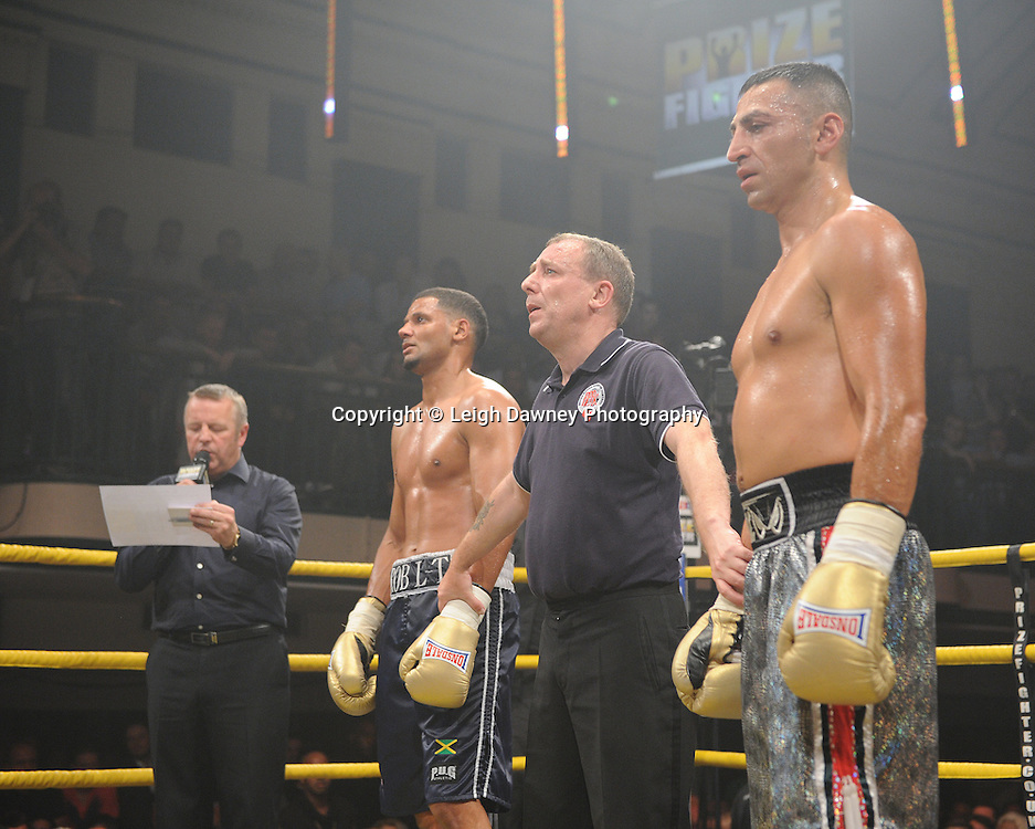 Robert Lloyd Taylor (charcoal shorts) defeats Mehrdud Takaloo at Quarter Final One  - The Light Middleweights II. York Hall, Bethnal Green, London, UK. 15th September 2011. Photo credit: © Leigh Dawney.