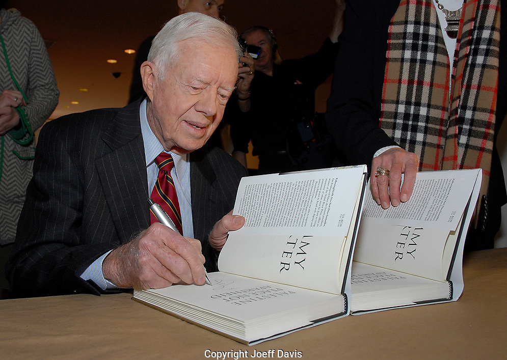 "ATLANTA, GA - DEC 8, 2006: Former president Jimmy Carter signs copies of his book ""Palestine: Peace Not Apartheid"" at the Carter Center. Carter also spoke at the event defending his book and speaking of his commitment to finding peace in the Middle East, ""The greatest commitment in my life has been trying to bring peace to Israel,"" Carter said, adding ""Israel will never have peace until they agree to withdraw"" from the occupied territories."""