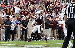 Texas A&M running back Keith Ford (7) crosses the goal line for a touchdown against Auburn during the second quarter of an NCAA college football game on Saturday, Nov. 4, 2017, in College Station, Texas. (AP Photo/Sam Craft)