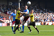 Scunthorpe United defender David Mirfin (6) heads ball  during the EFL Sky Bet League 1 match between Scunthorpe United and Bolton Wanderers at Glanford Park, Scunthorpe, England on 8 April 2017. Photo by Ian Lyall.