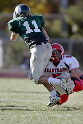 07 October 2006: Eric Haldeman aims for Nick Panno's knees. The Titans of Illinois Wesleyan University started off strong with a touchdown on the 2nd play from scrimmage in the game.  The Titans led most of the way, but failed to maintain the lead in the 4th quarter giving up the decision of this CCIW conference game to the Red Men of Carthage by a score of 31 - 28. Action was at Wilder Field on the campus of Illinois Wesleyan University in Bloomington Illinois.
