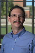 Paul King of Ohio University's Institute of Nuclear & Particle Physics (INPP) poses for a portrait in the Living Learning Center for a portrait on September 27, 2016.