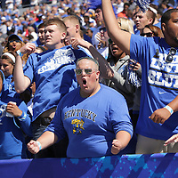 UK students Corey Reeves, left, Jake Borders, Davy Wantz and Tyler Homan, cheer for their Wildcats at the start of the first half as the University of Kentucky plays the University of Louisville at Commonwealth Stadium in Lexington, Ky. Saturday Sept. 14, 2013. Photo by David Stephenson