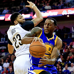 Oct 28, 2016; New Orleans, LA, USA;  Golden State Warriors forward Andre Iguodala (9) is defended by New Orleans Pelicans forward Anthony Davis (23) during the second quarter of a game at the Smoothie King Center. Mandatory Credit: Derick E. Hingle-USA TODAY Sports