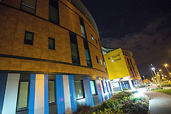 "© Licensed to London News Pictures . 25/05/2013 . Salford , UK . General view GV of Salford Royal Hospital early this morning (Saturday 25th May) as two people have been arrested following reports of a man with a gun at Salford Royal Hospital in Greater Manchester yesterday evening (Friday 24th May) . A police statement said "" A man has been arrested on suspicion of possession of a section 1 firearm and false imprisonment, and a woman has been arrested on suspicion of possession of a section 1 firearm."" Photo credit : Joel Goodman/LNP"