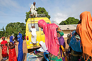 A family arrive at the local mosque in Sinchu in a mini-van to pray during the first day of Tabaski.<br /> Eid al-Adha, or known as Tabaski in West Africa, is also called the Feast of Sacrifice. Celebrated throughout the Muslim world is the second of the two Eid celebrations. During Tabaski every family will buy a goat which will be sacrificed and the meat distributed between the family and friends.