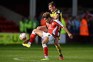 Tom Bradshaw of Walsall does battle with Alex Gilbey of Colchester United during the Sky Bet League 1 match between Walsall and Colchester United at the Banks's Stadium, Walsall<br /> Picture by Richard Blaxall/Focus Images Ltd +44 7853 364624<br /> 06/09/2014