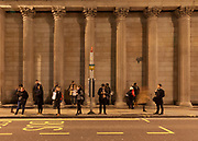 People waiting at a bus stop in Bank in London. Friday January 5th 2018