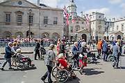 Many of the veterans are in wheelchairs pushed by personel from the armed forces and emergency services. VE Day 70 commemorations -  marking historic anniversary of end of the Second World War in Europe. following a Service of Thanksgiving at Westminster Abbey, a parade of Service personnel and veterans, led by a military pipe band, and a flypast - down whitehall and into Horse Guards Parade.