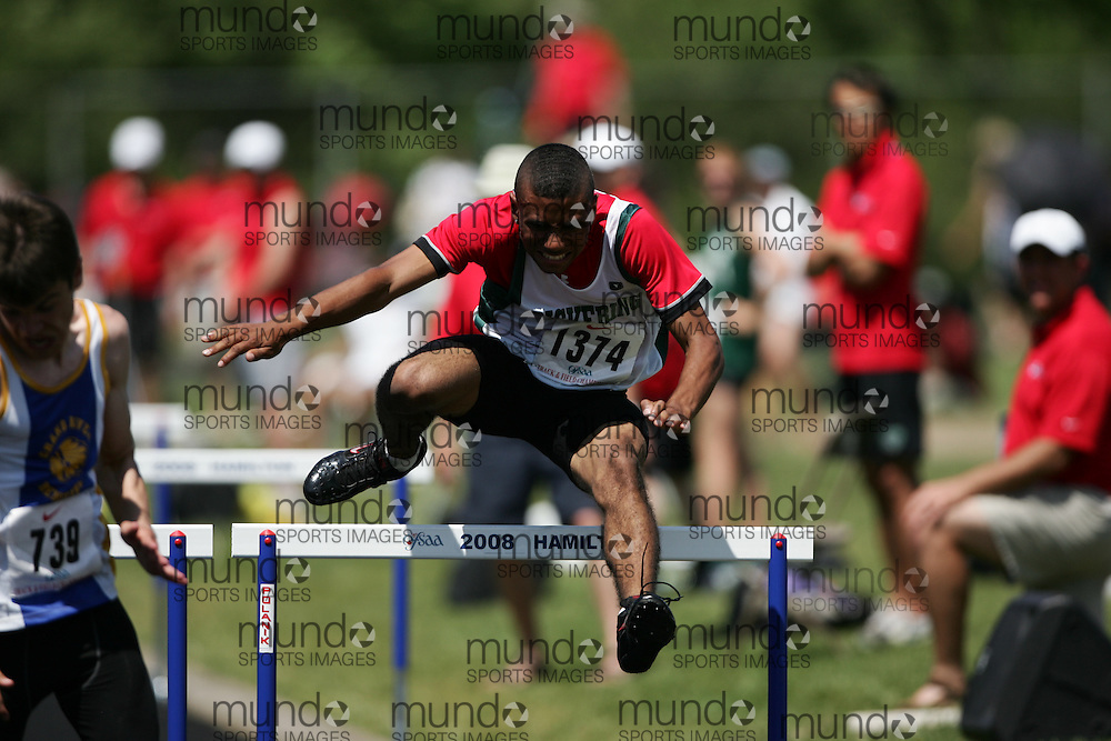 Hamilton, Ontario ---06/06/08--- Preston Farrell of Pickering in Ajax competes in the sprint hurdles at the 2008 OFSAA Track and Field meet in Hamilton, Ontario..SEAN BURGES
