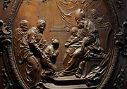Presentation of the Virgin in the temple, detail, bas-relief in a medallion on the sculpted wooden choir stalls, of which 78 of 114 remain, 52 upper and 26 lower stalls, carved by Jean Noel and Louis Marteau after drawings by Rene Charpentier and Jean Dugoulon, early 18th century, in the choir of the Cathedrale Notre-Dame de Paris, or Notre-Dame cathedral, built 1163-1345 in French Gothic style, on the Ile de la Cite in the 4th arrondissement of Paris, France. The high backs of the stalls are decorated with bas-reliefs and separated by trumeaux decorated with foliage and instruments of the Passion. Photographed on 17th December 2018 by Manuel Cohen