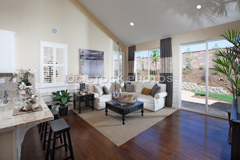 Living Room with White Fabric Sectional and black furniture