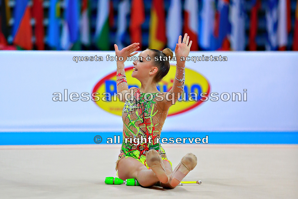 "Averina Dina during clubs routine at the International Tournament of rhythmic gymnastics ""Città di Pesaro"", 11 April, 2015. Dina was born on August 13, 1998 in Zavolzhye, Russia. Dina has a twin sister ,Arina is also herself a great gymnast member of the Russian National Team.<br />