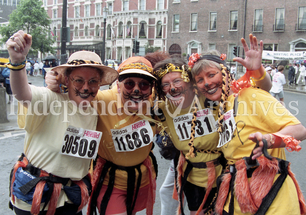 1998 Women's Mini Marathon sponsored by the Evening Herald, 7/6/98..<br /> Four ladies dressed up and wearing costume make-up participate in the mini marathon, pictured at St Stephen's Green.<br /> (Part of the Independent Newspapers Ireland/NLI Collection).