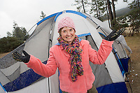 Senior woman standing in front of tent, portrait