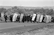 Police use riot gear for the first time in an industrial dispute during the miners'strike. Orgreave, 30 May 1984