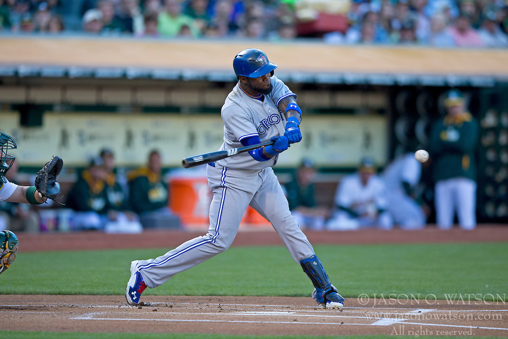 OAKLAND, CA - JULY 05:  Jose Reyes #7 of the Toronto Blue Jays hits a single against the Oakland Athletics during the first inning at O.co Coliseum on July 5, 2014 in Oakland, California. (Photo by Jason O. Watson/Getty Images) *** Local Caption *** Jose Reyes