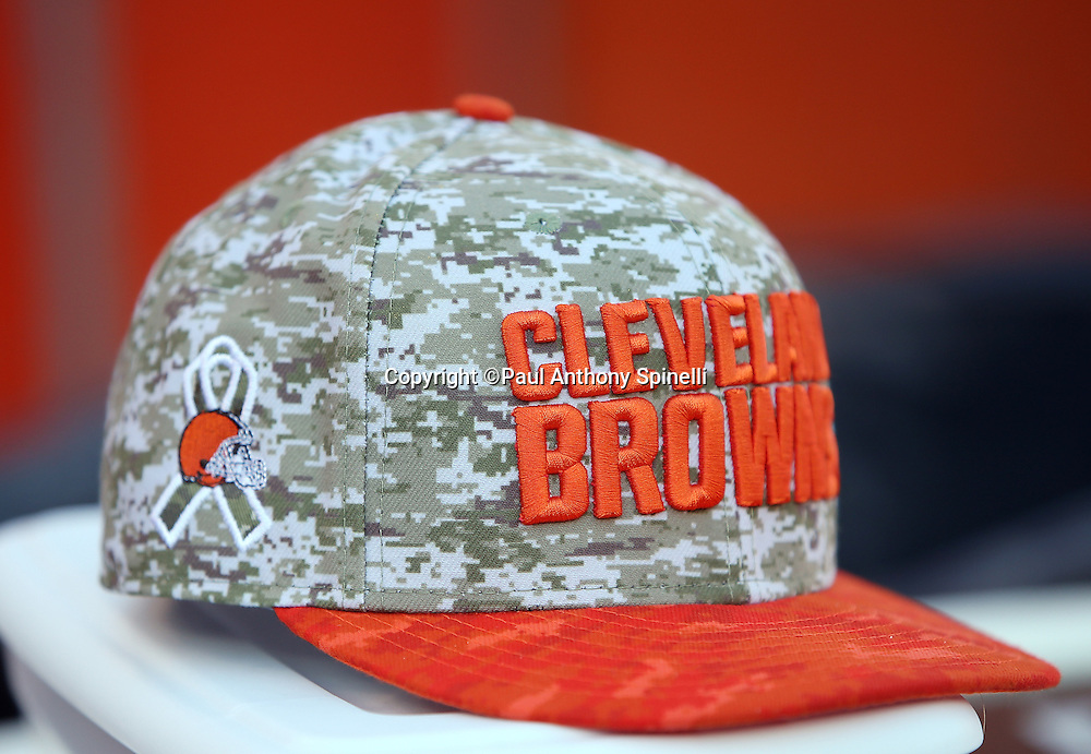 A Cleveland Browns cap is decorated with an NFL logo intertwined with a salute to the military logo before the Cleveland Browns 2015 week 8 regular season NFL football game against the Arizona Cardinals on Sunday, Nov. 1, 2015 in Cleveland. The Cardinals won the game 34-20. (©Paul Anthony Spinelli)