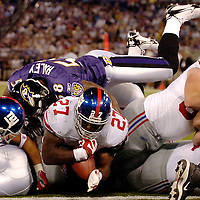 11 August 2006:  The New York Giants Brandon Jacobs (27) scores a touchdown on a one yard run up the middle in the second quarter against the Baltimore Ravens in a pre-season game won by the Giants 17-16 at M&T Bank Stadium in Baltimore, Md. .
