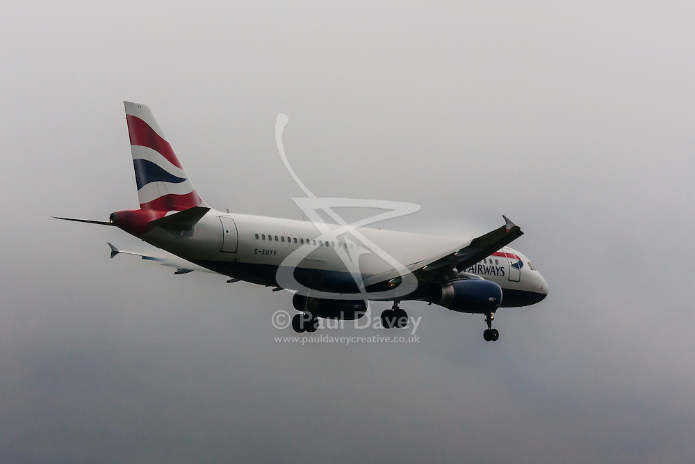 "January 3rd 2015, Heathrow Airport, London. Low cloud and rain provide ideal conditions to observe wake vortexes and ""fluffing"" as moisture condenses over the wings of landing aircraft. With the runway visible only at the last minute, several planes had to perform a ""go-round"", abandoning their first attempts to land. PICTURED: Water vapour ""fluffing"" over the wings of a British Airways Airbus A319 as it lands at Heathrow Airport on runway 27L"