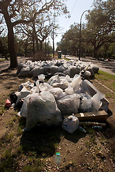 06 Oct, 2005.  New Orleans, Louisiana.  Hurricane Katrina aftermath. <br /> Garbage piles up on the Mardi Gras parade route and street car line of St Charles Ave in the Uptown neighbourhoods.<br /> Photo; &copy;Charlie Varley/varleypix.com