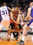 Nov. 21, 2012; Phoenix, AZ, USA; Portland Trail Blazers forward Jared Jeffries (1) looses his grip on the ball during the game against the Phoenix Suns guard Sebastian Telfair (31) in the first half at US Airways Center. Mandatory Credit: Jennifer Stewart-US PRESSWIRE