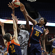 UNCASVILLE, CONNECTICUT- MAY 05:  Astou Ndour #45, (center), of the San Antonio Stars drives to the basket challenged by Kelly Faris #34, (left) and Jonquel Jones #35 of the Connecticut Sun during the San Antonio Stars Vs Connecticut Sun preseason WNBA game at Mohegan Sun Arena on May 05, 2016 in Uncasville, Connecticut. (Photo by Tim Clayton/Corbis via Getty Images)