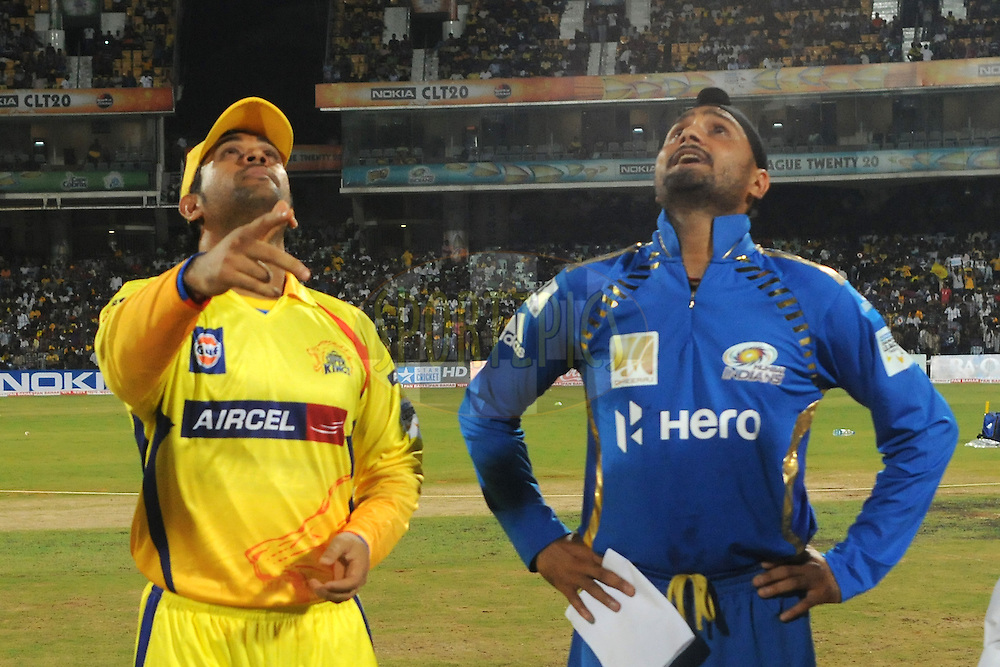 Mahendra Singh Dhoni captain of Chennai Super Kings and Harbhajan Singh of Mumbai Indians during the toss before the start of the match 3 of the NOKIA Champions League T20 ( CLT20 )between the Chennai Superkings and the Mumbai Indians held at the M. A. Chidambaram Stadium in Chennai , Tamil Nadu, India on the 24th September 2011..Photo by Pal Pillai/BCCI/SPORTZPICS