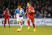 York City midfielder James Barrett gets away from Bristol Rovers forward, on loan from Millwall, Paris Cowan-Hall   during the Sky Bet League 2 match between Bristol Rovers and York City at the Memorial Stadium, Bristol, England on 12 December 2015. Photo by Simon Davies.