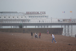 © Licensed to London News Pictures. 10/07/2016. Brighton, UK. Few people brave the wet and windy weather to spent the day at the beach in Brighton. Photo credit: Hugo Michiels/LNP